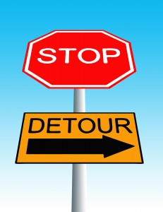 stop roadsign with detour sign